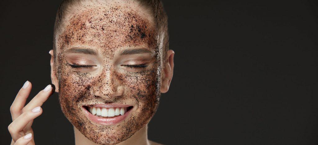 Girl using face scrub