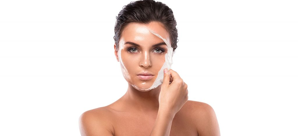 Girl peeling off face mask